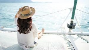 A woman on a catamaran